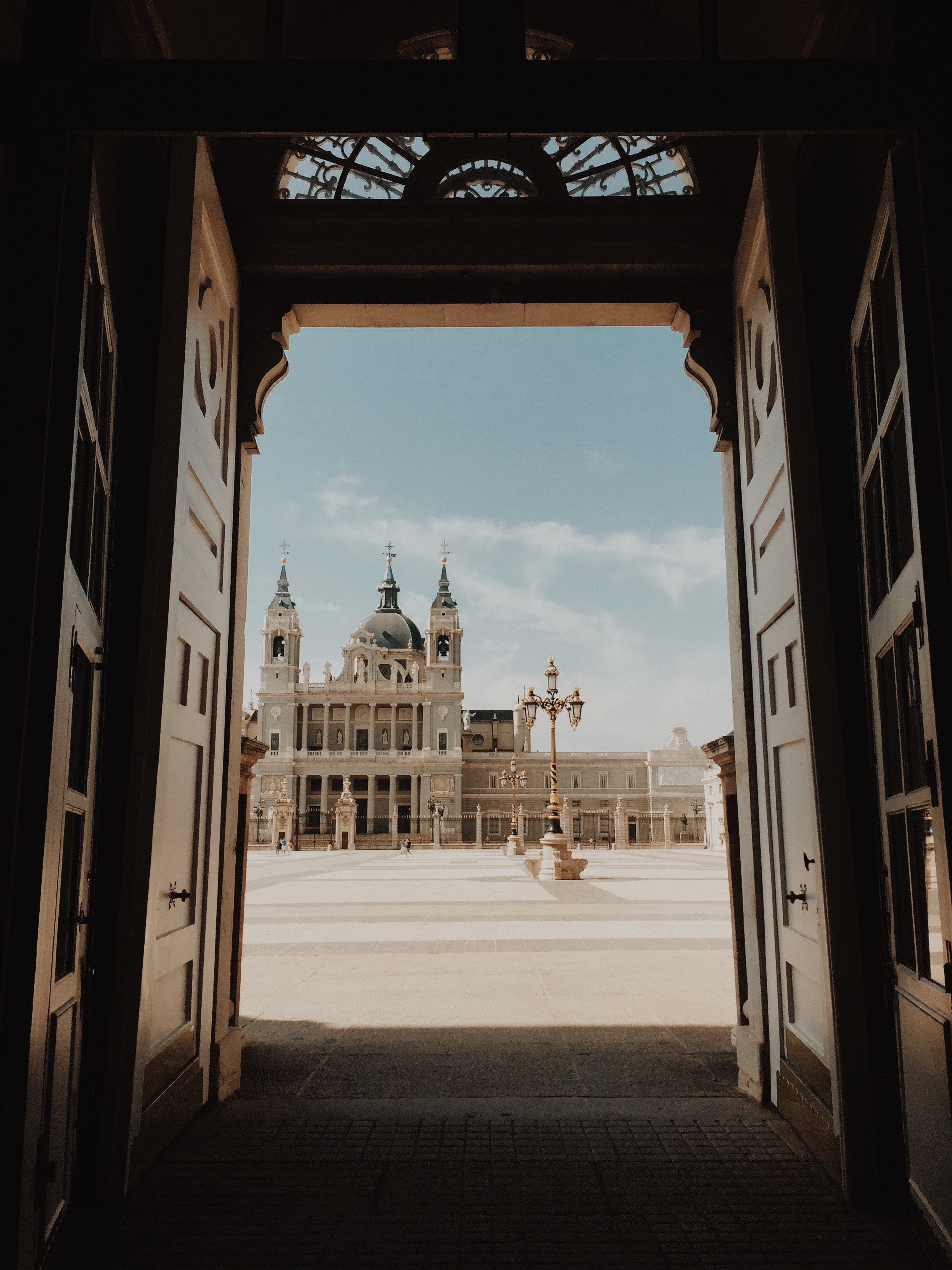 opened-door-with-view-of-cathedral-2406875